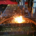 """Torch cutting a 1"""" thick base plate."""